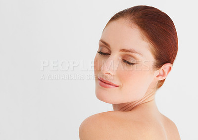 Buy stock photo A young, beautiful woman looking over her shoulder