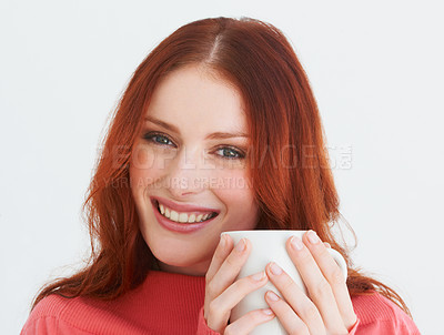 Buy stock photo Portrait of a young woman holding a coffee mug