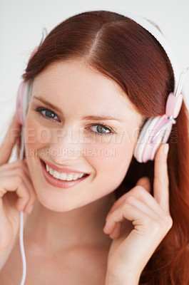Buy stock photo Closeup of a young woman with earphones