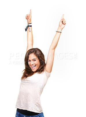 Buy stock photo Portrait of a beautiful young woman standing with her hands in the air