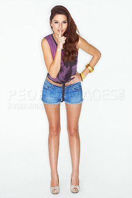 Buy stock photo An attractive and fashionable young woman posing against a white background