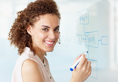Buy stock photo A young businesswoman drawing a diagram