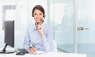 Buy stock photo A businesswoman wearing a headset and holding a pen