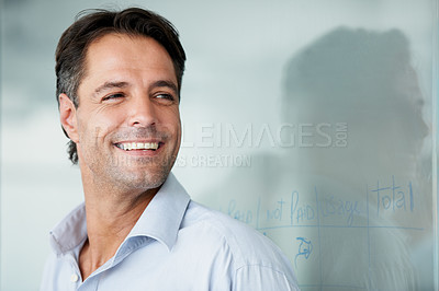 Buy stock photo A businessman smiling with a balance sheet in the background