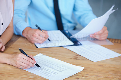 Buy stock photo Torso only shot of businesspeople signing documents
