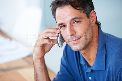 Buy stock photo A mature businessman making a phone call