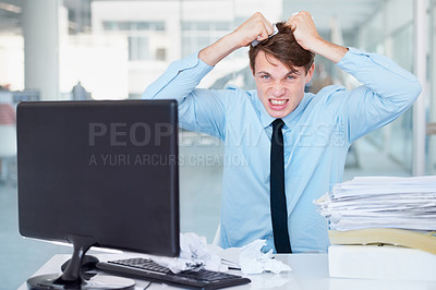 Buy stock photo A businessman tearing at his hair