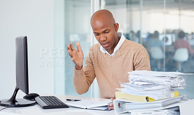 Buy stock photo A businessman trying to consolidate his work