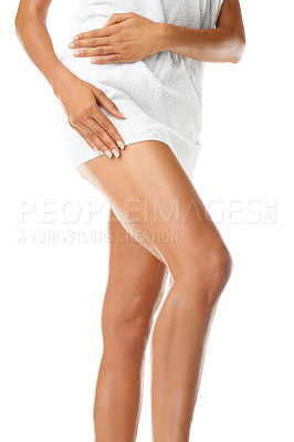 Buy stock photo Cropped image of a woman wrapped in a towel holding one bare leg forward