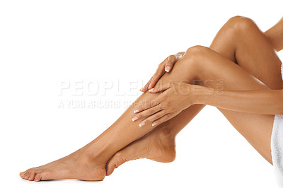 Buy stock photo Studio shot of a young woman's beautiful legs isolated on white