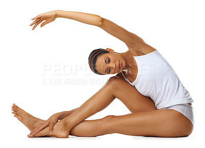 Buy stock photo Studio shot of a young woman with gorgeous skin stretching isolated on white