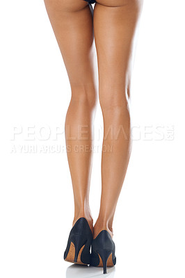 Buy stock photo Studio shot of a woman with shapely legs wearing stilettos isolated on white