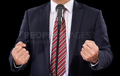 Buy stock photo Cropped view of a man in a suit speaking into a microphone with his hands in fists