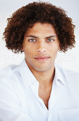 Buy stock photo A handsome young man looking at the camera