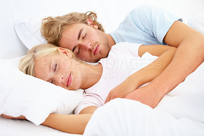 Buy stock photo A young couple fast asleep in bed together
