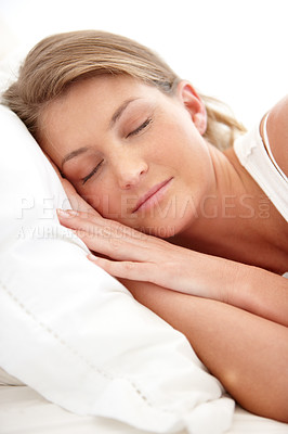 Buy stock photo A pretty young woman resting peacefully in her bed