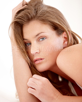 Buy stock photo Portrait of a stunning young woman lying on her bed