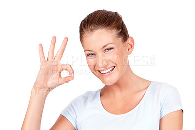 Buy stock photo A lovely young woman showing you the 'a-okay' sign while isolated on a white background