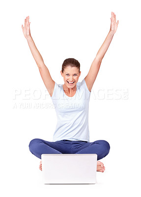 Buy stock photo A young woman celebrating while using her laptop on a white background