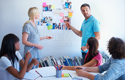 Buy stock photo Cropped shot of two businesspeople giving a presentation in the boardroom