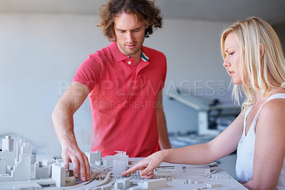 Buy stock photo Cropped shot of two businesspeople working on their building project