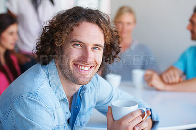 Buy stock photo Cropped shot of a group of coworkers sitting in the cafeteria