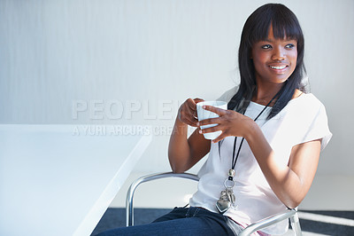 Buy stock photo Cropped shot of a young businesswoman sitting in the cafeteria