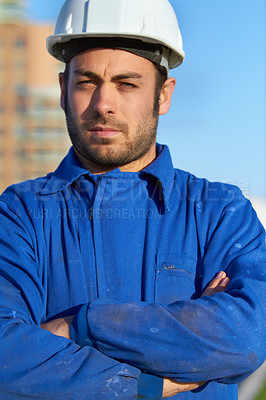 Buy stock photo Portrait of a stern construction worker crossing his arms