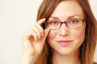 Buy stock photo Cropped portrait of a beautiful young redhead wearing glasses