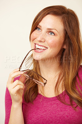 Buy stock photo Portrait of a beautiful young woman biting her spectacles