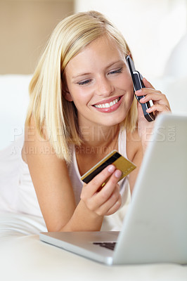 Buy stock photo A gorgeous young woman buying something online with her credit card