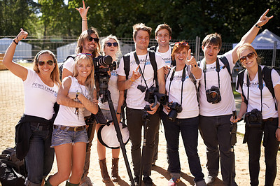 Buy stock photo Group photo of a team of happy photographers at a music festival