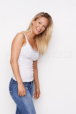 Buy stock photo A gorgeous young woman smiling against a white background