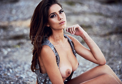 Buy stock photo Portrait of a beautiful young woman wearing a sequinned waistcoat with her breasts exposed