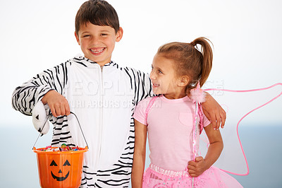 Buy stock photo Cropped shoy of two cute kids dressed up and ready for Halloween