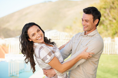 Buy stock photo A cute couple enjoying the outdoors together
