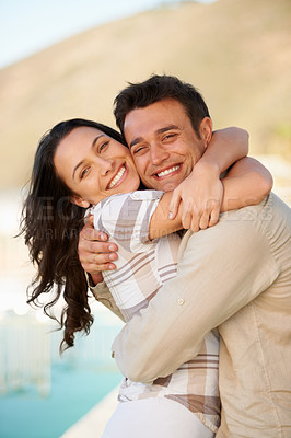 Buy stock photo A cute couple embracing each other outdoors