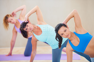 Buy stock photo Young pilates instructor leading a class - rear view
