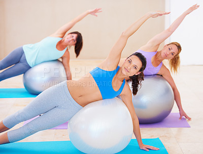 Buy stock photo Group of woman enjoying a pilates class together