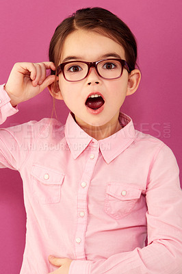 Buy stock photo A little girl with an astounded expression standing against a pink background
