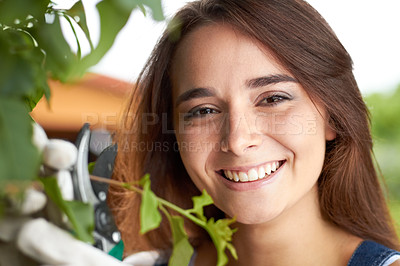 Buy stock photo Closeup portrait of an attractive young woman working in her garden