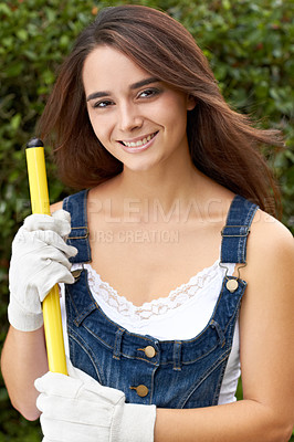 Buy stock photo Portrait of a beautiful young woman holding a rake