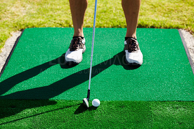 Buy stock photo Cropped image of a golfer about to tee off