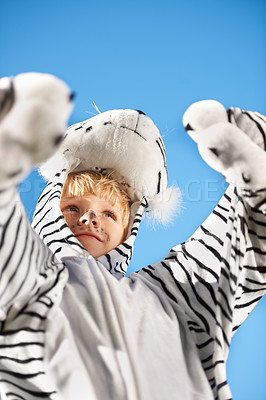 Buy stock photo Little kid wearing a tiger costumer with his arms raised