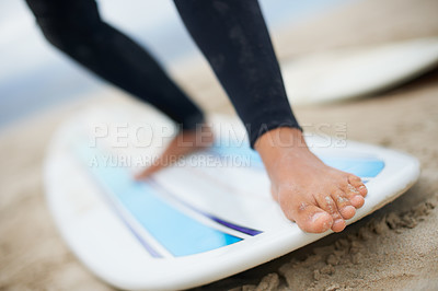 Buy stock photo Cropped shot of an unrecognizable female surfer's feet on a surfboard