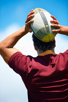 Buy stock photo Rearview shot of a rugby player taking a lineout