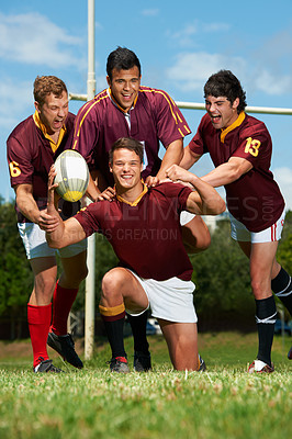 Buy stock photo Full length portrait of a young rugby team celebrating the scoring of a try