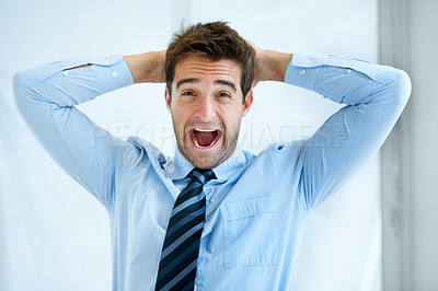 Buy stock photo Portrait of a young businessman screaming with hands behind his head