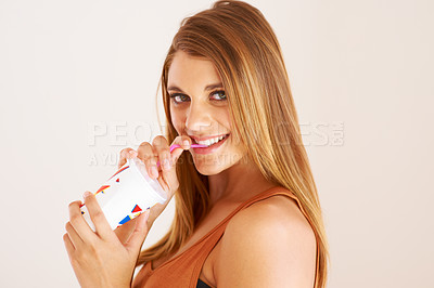 Buy stock photo A young woman drinking a soda