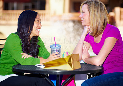 Buy stock photo Two young woman stopping to have lunch while out shopping